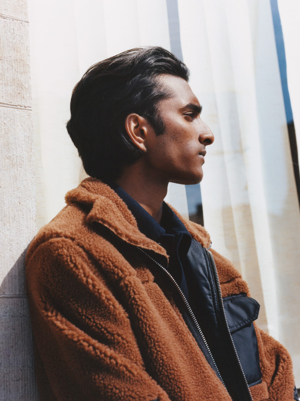 Male model wearing a brown pike jacket
